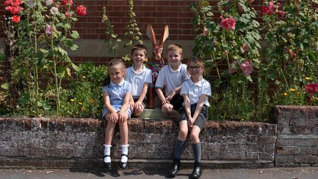 Children from Eye Primary School with a hare sculpture