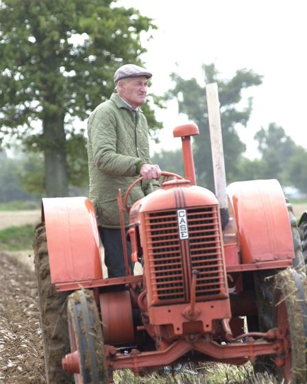 Billy Hammond, president of Holt Farmers' Club, driving his 1942 Case tractor at Tunstead Trosh