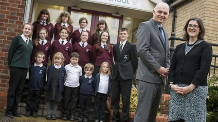 Head Rob Martlew and Kate Atkins, head of primary phase, with pupils. Picture: Matthew Usher.