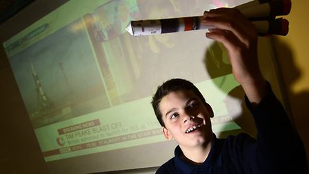 CNS students watch Tim Peake's live rocket launch. Student Josh Harman, 11, with a model rocket.Pict