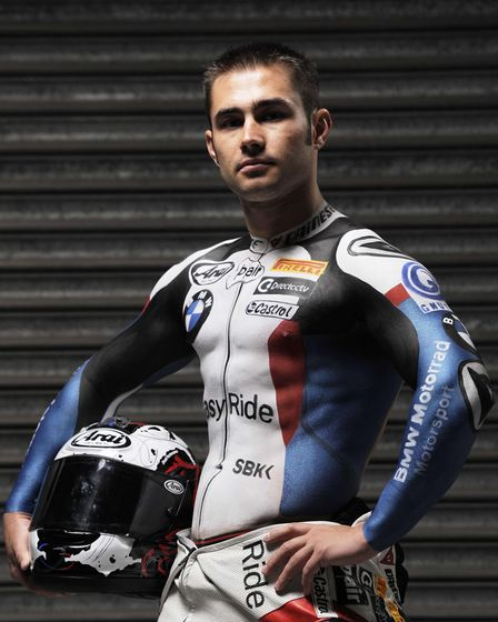 Superbike rider Leon Haslam covered in a painted bodysuit