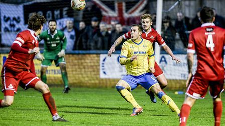 Action from King's Lynn Town v Frome Town at The Walks - Lynn's Jacek Zielonka on the ball. Picture: