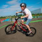 A young boy riding a bike on the Learn to Ridecycle area at Northern Gateway Sports Park