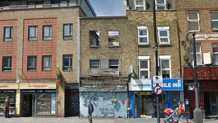 Theburned out building in BethnalGreen Road where the two firefighters were killed.