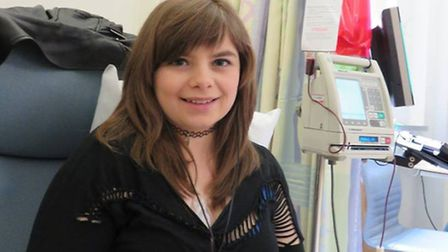 Emily Robb, from East Harling, while receiving a blood transfusion