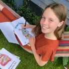 Betsy King colouring in 'Proud Pooch' in the book.