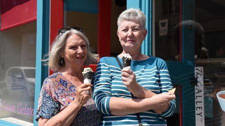 Customers Denise Talbot and Janice Gemwood enjoying an ice cream. Ugur Vata owner of the Galley in W