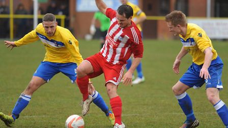 Action from when Norwich United, yellow, took on Godmanchester earlier this year. Picture: DENISE B