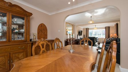 Large open-plan dining room with huge oak table to seat six and pine display cabinets