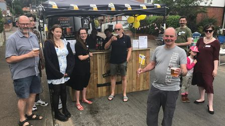 Steve Carey, won the Norfolk Day bar competition which tied in with the road's street party celebrations.