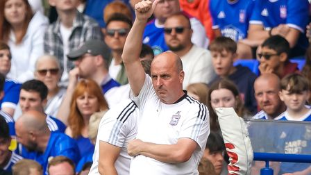 Town manager Paul Cook acknowledges fans calling for a wave.