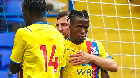 Wilfried Zaha is congratulated after scoring the only goal of the game from the penalty spot.