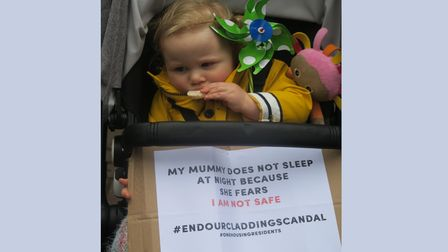 Toddler joins mum in protest at CanaryWharfinMay to get cladding removed from tower blocks