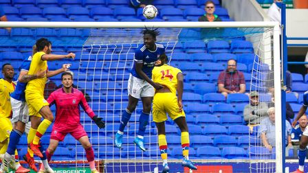 Toto Nsiala rises high to win the ball.