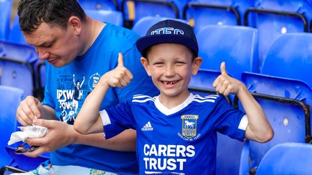 A young Town fan looks pleased to be back at Portman Road.