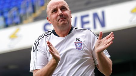 Town manager Paul Cook applauds fans ahead of the game.