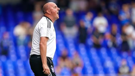 Town manager Paul Cook yells instructions to his players.
