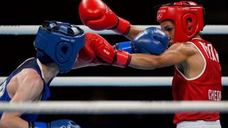 Morrocco's Rabab Cheddar, right, exchanges punches with Britains' Charley-Sian Davison during their