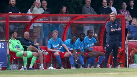 Dagenham manager Daryl McMahon (R) looks on from the dugout area during Hornchurch vs Dagenham & Red