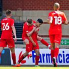 Leyton Orient players celebrate Ruel Sotiriou's (centre) first goal for his side during the pre-seas