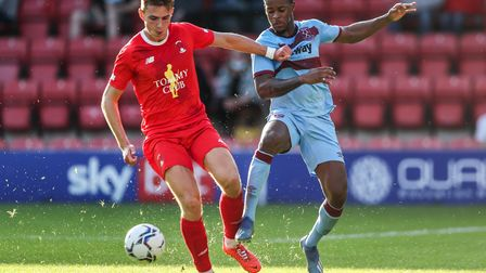 Leyton OrientÕs Hector Kyprianou (left) and West Ham United's Xande Silva (right) battle for the bal