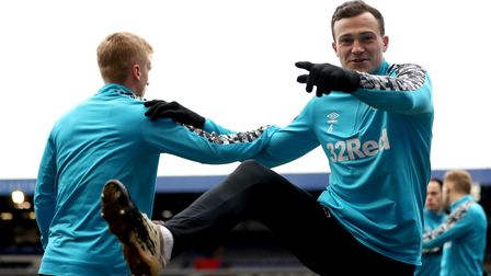 Derby County's George Edmundson (right) warms up on the pitch ahead of during the Sky Bet Championsh