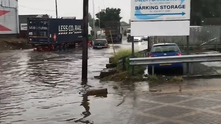 Vehicles driving through flood water in Renwick Road