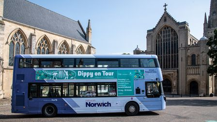 Children greet the Dippy bus at the west front of the Cathedral. Photograph: Norwich Cathedral/Bill