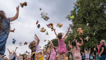 Bears and soft toys are thrown into the air at Great Dunmow's Teddy Bears' Picnic 2021 in Uttlesford, Essex