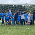 Wapping Youth Football Club face the camera