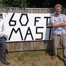 Duncan Baker, left, with nearby residentMatthew Hughes at a gathering to prot