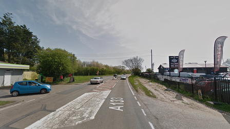 The A133 is closed in both directions following a two vehicle collision