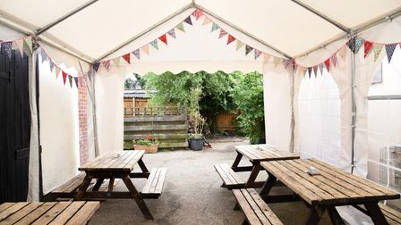A marquee has been set up in the garden of The Poachers Pocket in Carlton near Saxmundham for outdoor dining