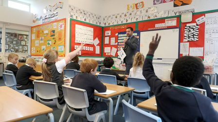 File photo dated 5/11/2020 of pupils during a lesson in a classroom. The proportion of pupils attend