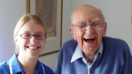 Caremark in Uttlesford and Chelmsford staff member with an older man, laughing and having fun
