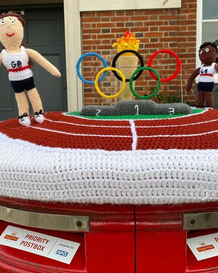 A Great Dunmow, Essex Royal Mail postbox is transformed, with a knitted top showing Tokyo Olympics 2020