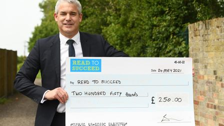 MP Steve Barclay with a donation to his annual Read to Succeed campaign.