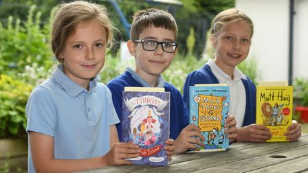 Millfield Primary School students in Littleport with their new books thanks to MP Steve Barclay's Read to Succeed campaign.