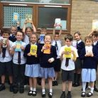 Downham Feoffees students with their new books thanks to MP Steve Barclay's annual Read to Succeed campaign.