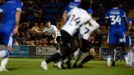 Wes Burns scores with a late free-kick to earn Ipswich a 3-3 draw at Colchester United