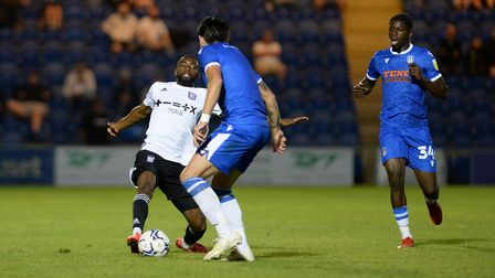 Kane Vincent-Young stretches for the ball at Colchester United