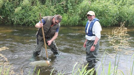 Workshop tutor Ian Hawkins withChris High in the River Wensum, during a training session on invertebrate identification