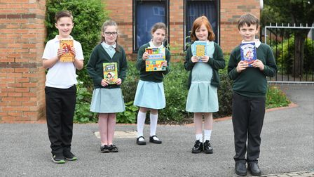 Christchurchstudentwith their new bookthanks to MP Steve Barclay's annual Read to Succeed campaign.