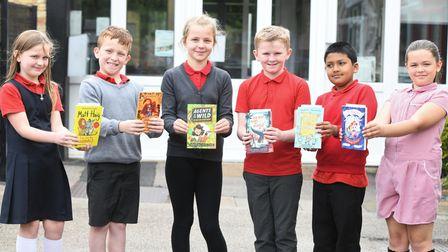 Burrowmoor studentswith theirnew books thanks to MP Steve Barclay's annual Read to Succeed campaign.