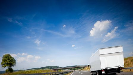 White truck driving on a european highway.