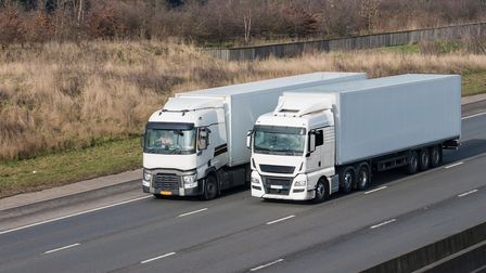 Two lorries on the motorway driving side to side. Picture: Getty Images/iStockphoto