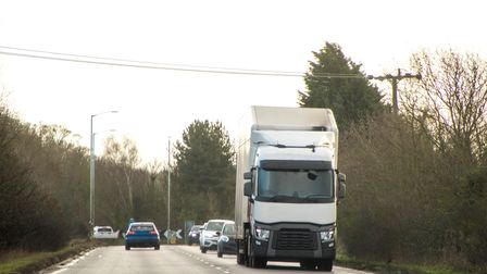 A large HGV travels across country to deliver or collect goods for the next business location. Pictu
