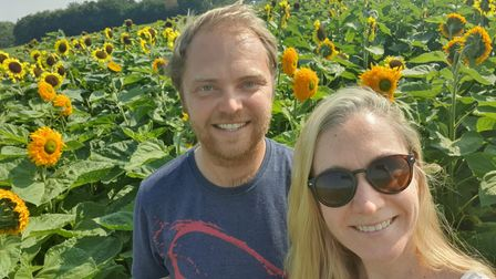 Freddy Vaudrey and Bekkie Hatwell among the sunflowers at their farm near Eye