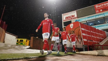 Barnsley's Conor Chaplin (left) walks from the tunnel before the Sky Bet Championship match at Oakwe