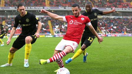 Barnsley's Conor Chaplin (centre) in action during the Sky Bet Championship match at Oakwell, Barnsl